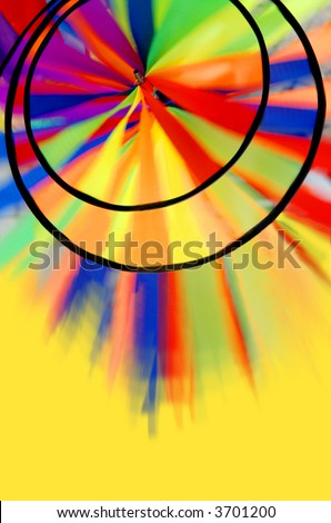 abstract colorful spinning pinwheel background on yellow - stock photo