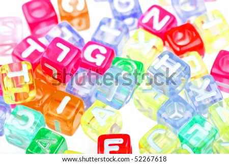 Abstract colourful alphabet blocks to background