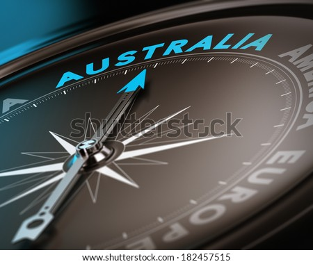 Abstract compass needle pointing the destination australia, blue and brown tones with focus on the main word. Concept image suitable for illustration of trip counseling. - stock photo