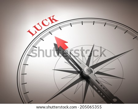 abstract compass with needle pointing the word luck in red and white tones - stock photo