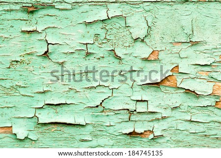 Abstract composition from a wooden door with old, peeled paint