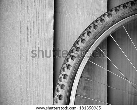 Abstract composition of a used mountain bike wheel in black and white - stock photo