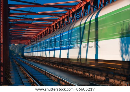 Abstract composition of moving train on the old railway bridge - stock photo