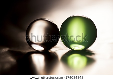 Abstract composition with beautiful, green and clear, round jelly balls on an aluminium foil with reflexions - stock photo
