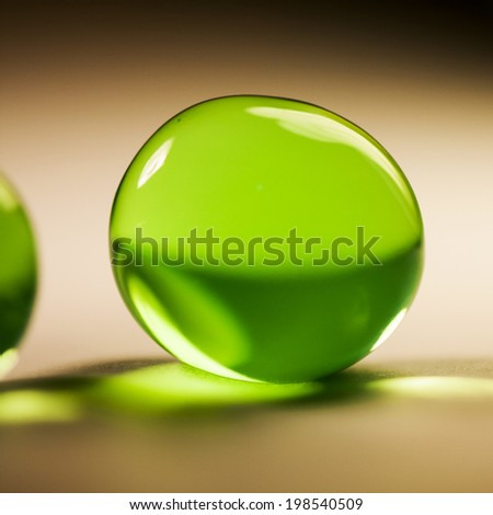 Abstract composition with beautiful, green, round jelly balls, paper surface and paper background - stock photo