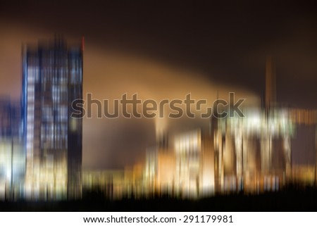 Abstract composition with blurred petrochemical plant in night - stock photo