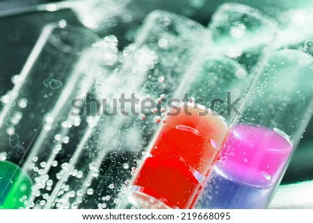 Abstract composition with underwater tubes with colorful jelly balls inside and bubbles