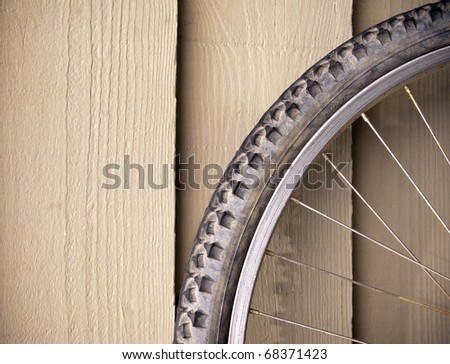 Abstract compostion of a used mountain bike wheel - stock photo
