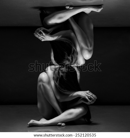 Abstract concept. Beautiful bodies of young women over dark background - stock photo
