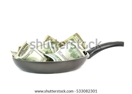 Abstract concept. Dollars in frying pan isolated on white