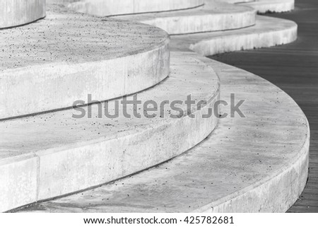 Abstract concrete interior fragment, curved stairs. Photo with selective focus - stock photo