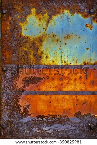 Abstract corroded colorful wallpaper crack grunge background iron rusty artistic wall peeling paint. - stock photo