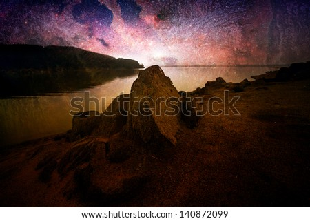 abstract cosmos landscape with lake and rocks- elements of this image furnished by NASA - stock photo