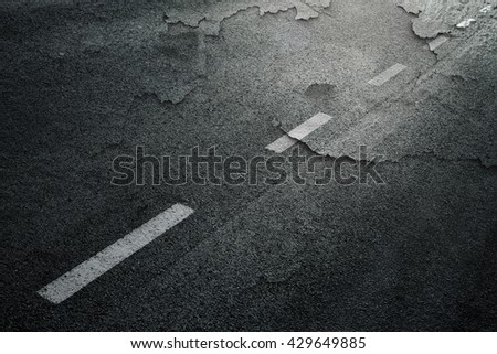 Abstract cracked and destroyed asphalt road background.