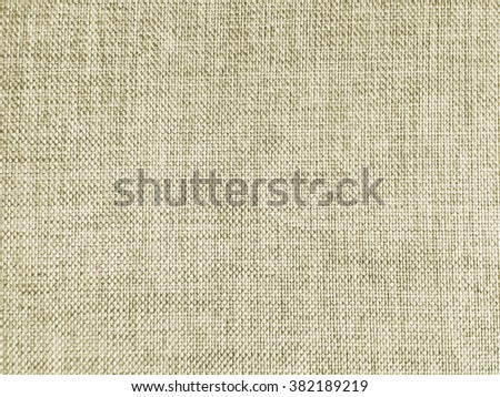 Abstract crumpled beige cream color fabric texture background:rough/creased fabric textures in vintage color.wrinkle fabric burlap backdrop concept.tan garment textile wallpaper for banner template - stock photo