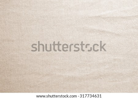 Abstract crumpled sepia brown colors fabric texture backgrounds : rough and creased fabric textures in vintage sepia color style.wrinkle fabric burlap backdrop concept. - stock photo