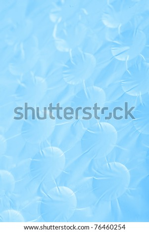 Abstract crumpled silver aluminum foil closeup background texture, in blue - stock photo