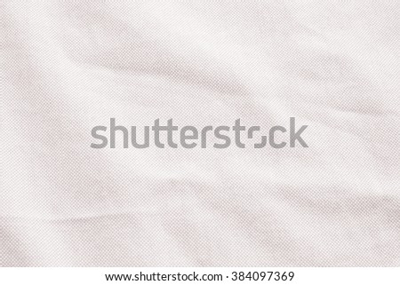 Abstract crumpled soft pink rose colors fabric texture backgrounds :crinkle and creased fabric textures in bright beige color tone. - stock photo