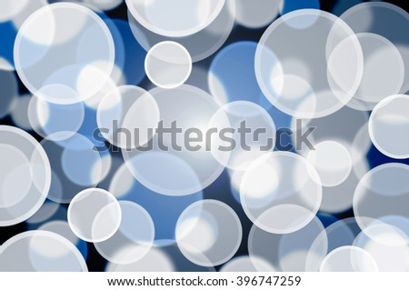 Abstract dark blue background bokeh white.