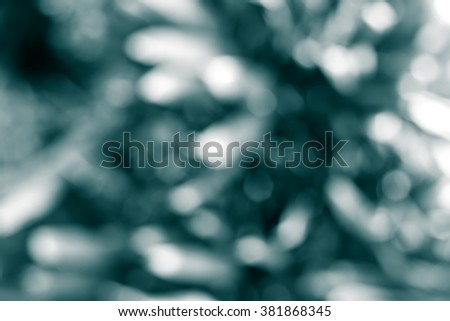 Abstract Dark Blue Monochrome Bokeh Background - stock photo