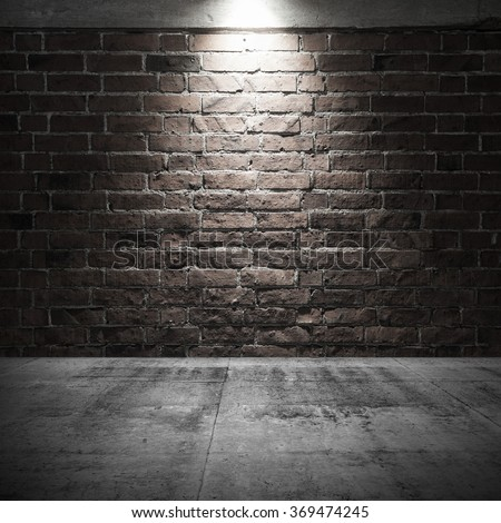 Abstract dark interior background with concrete floor and brick wall with spot light illumination - stock photo