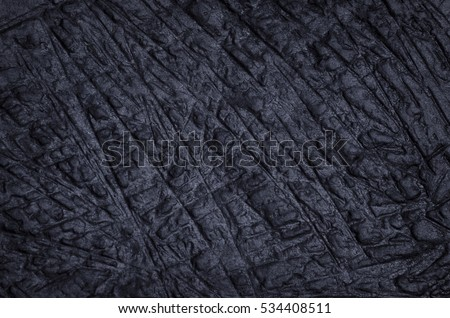 Abstract dark stone texture.