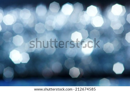abstract defocused bokeh background in cold blue colors. - stock photo