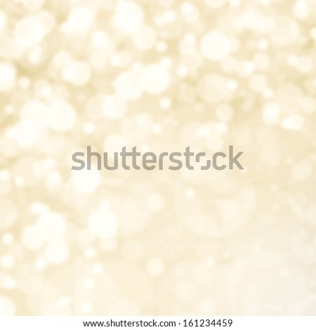Abstract Defocused Christmas background texture with  glowing magic bokeh, festive lights with copyspace, soft golden color. - stock photo