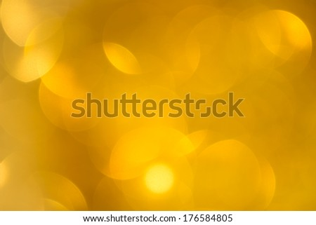 Abstract defocused gold bokeh background - stock photo