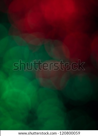 abstract defocused round shaped green and red lights on black background - stock photo