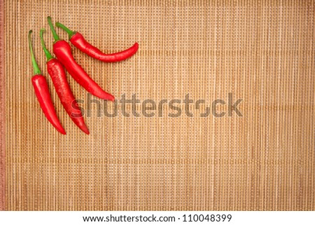 abstract design background vegetables on a bamboo mat background - stock photo