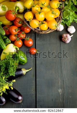 abstract design background vegetables on a wooden background - stock photo