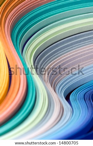 Abstract design of filigree paper strips folded in waves - stock photo