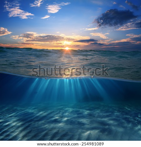 Abstract design template with underwater part and sunset skylight splitted by waterline - stock photo