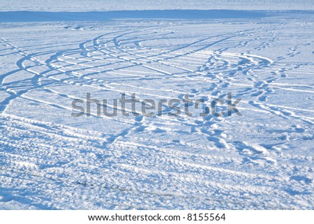 Abstract design - tire tracks in snow - stock photo