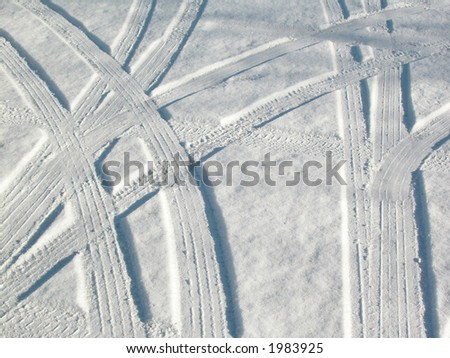 Abstract design - tire tracks in snow in and Ottawa, Ontario street. - stock photo