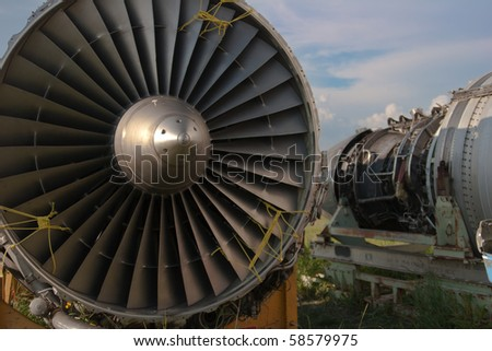 Abstract detail of an airplane engine in junkyard - stock photo