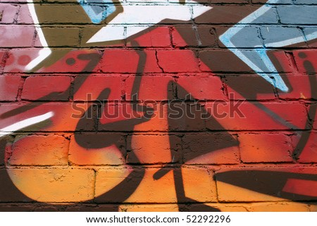 Abstract Detail of Graffiti on a Brick Wall - stock photo