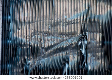 Abstract detail of the exterior of an air conditioning unit showing damage to the fins - stock photo
