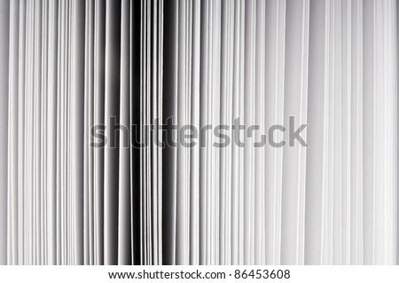 Abstract detail of thick paper pages in book - stock photo