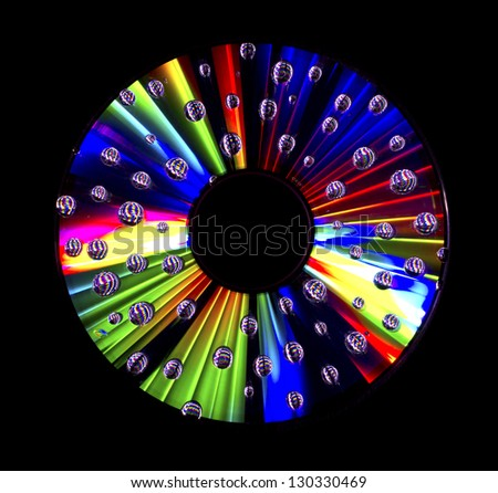 Abstract disc with water droplets isolated on black background - stock photo