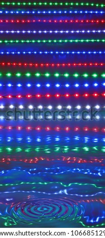 abstract disco lights reflected in water, discotheque diversity - stock photo