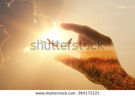 abstract double exposure man hand and plane over the sunset- easy travel with plane is in your hand concept  - stock photo