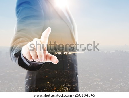 Abstract Double exposure of Business man touching an imaginary screen against white background - stock photo