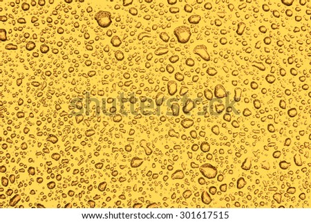 Abstract droplet background, dewdrops on golden metallic car - stock photo