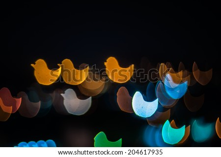 Abstract duck shape bokeh background of Kuala Lumpur city - stock photo