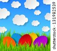 Abstract Easter eggs made of paper on colorful spring background with green grass, sky and clouds. Raster copy of vector illustration - stock photo