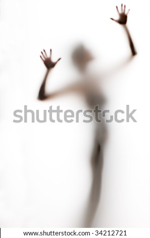 abstract, elongated, semi-obscured figure with arms raised - stock photo