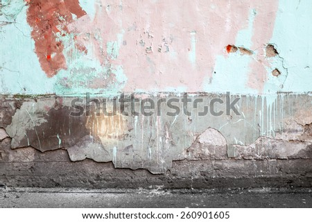Abstract empty abandoned urban interior fragment, old colorful wall and asphalt road - stock photo