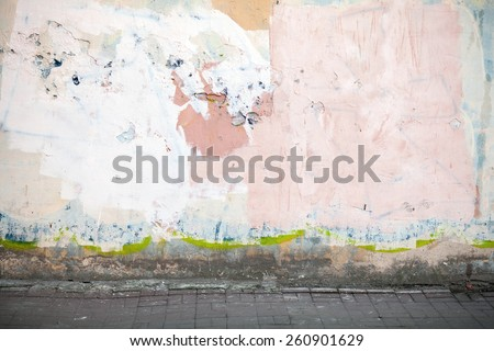 Abstract empty abandoned urban interior fragment, old concrete wall and road pavement - stock photo